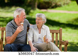 Senior couple eating an ice cream o