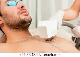 Man in cosmetic salon receiving waxing