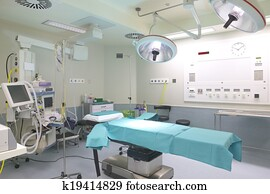 Surgery room with bed and machinery.