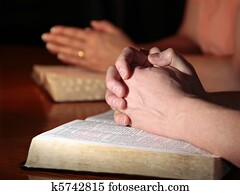 Man and Woman Praying with Bibles