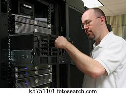 Computer Technician/network administrator working on a server.