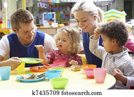 Couple and children playing with toys
