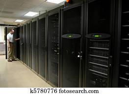 Technician working on racks of server