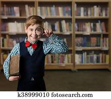 Male College Student Looking Through Bookshelf Images And Stock