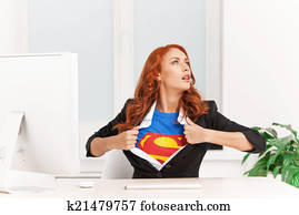 woman shows her superman uniform underneath her clothes. Super businesswoman sitting in office and taking off clothes