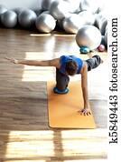 fitness - man practicing pilates
