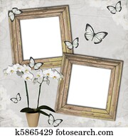 Wooden frames with butterfly and orchids on grange background