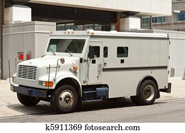 Armoured Armored Car Parked on Street Building