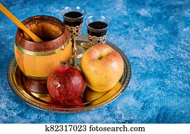 On the table in the synagogue are the symbols of Rosh Hashanah apple and pomegranate