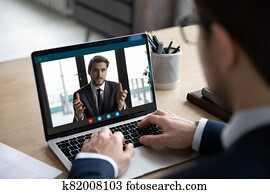Back view of businessman have video call with business partner
