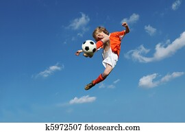 child playing football or soccer