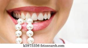 snow-white pearls of teeth