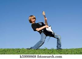 child playing guitar and singing