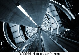 Futuristic architecture. Tunnel with moving sidewalk.