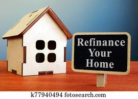 Refinance Your Home mortgage board and wooden house.