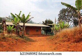 African House Made Of Red Earth Bricks Stock Photo K12669199