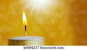 one burning candle with bright white light
