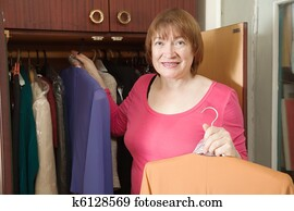 Mature women taking their clothes off