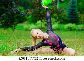 Flexible Little Girls Doing Gymnastics Split Stock Photo