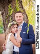 bride groom garden hugs