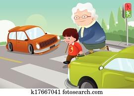 Kid helping senior lady crossing the street