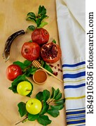 Yom Kippur concept. Fruits with honey and jewish tallit.