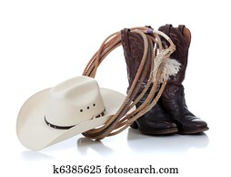 Cowboy hat, boots and lariat on white