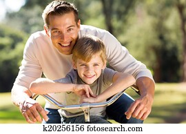 happy father and son on a bike