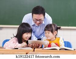 Teacher teaching children with digital tablet or ipad