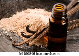 Vanilla With Bottle Of Essential Oil And Powder- Beauty Treatment