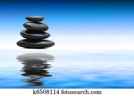 Zen stones over water