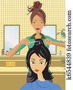 Front view of hairstylist cutting hair
