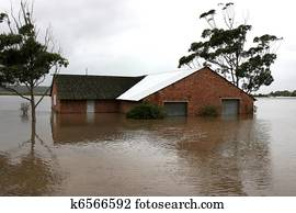 Flooded House on River Bank