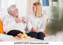 Young volunteer in nursing home