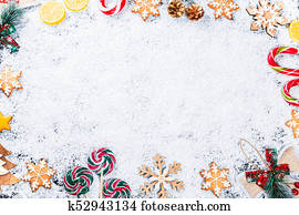 christmas background with gingerbread snowflakes white snow toys lemon candy and new