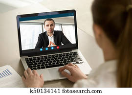 Businesswoman calling businessman online by video chat pc app, c