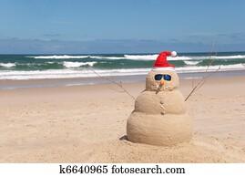 Sandman On Beach With Santa Hat And Sunglasses