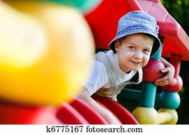 young autistic boy playing on playground