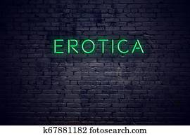 Brick wall at night with neon sign erotica