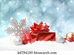 Christmas decorations on blue glittery background