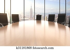 Conference room with big round table, chairs and city view
