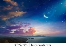 Ramadan Kareem background with crescent and stars