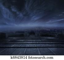 Dark clouds over urban background
