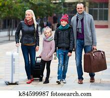 Parents with two kids chasing streets