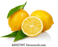 fresh lemons with cut and green leaves
