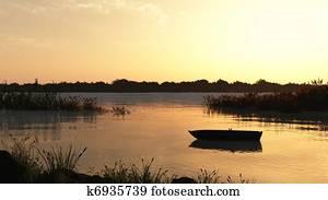 Reed Marsh and Boat at Dawn