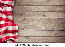 red picnic tablecloth on wood table background