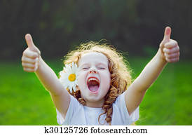 Laughing girl showing thumbs up.