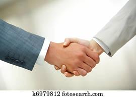 Handshake after striking deal