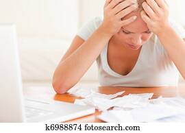 Worried blond woman accounting